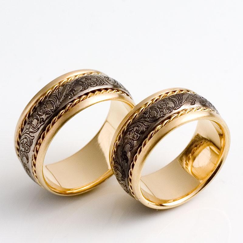 Trauringe außergewöhnlich  Außergewöhnliche Trauringe, 750- Gold, 925 Silber, mit barocker Gravur